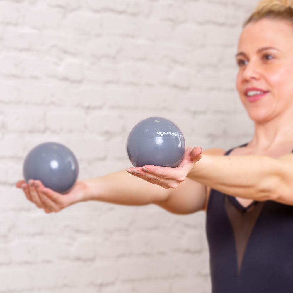 Pilates lady holding weighted balls